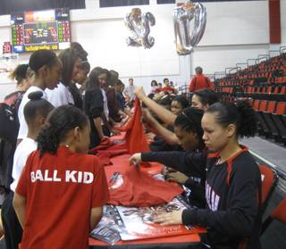 The UNLV Lady Rebels sign autographs for fans after a game Saturday, Feb. 27, 2010, against Air Force.
