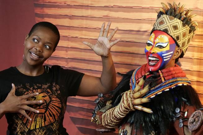 Buyi Zama, who plays Rafiki in The Lion King at Mandalay Bay, stands next to the wax figure of the Rafiki character during it's unveiling at Madame Tussauds Las Vegas Thursday, March 4, 2010.