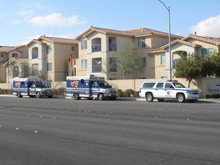 Emergency vehicles park outside the Silver Pines apartment complex, 6650 E. Russell Road,  where a fatal police-involved shooting occurred Monday afternoon. One woman was killed, and three others - including the suspect - were injured and taken to the hospital, police said.