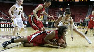 UNLV center Markiell Styles hits the ground after diving for a loose ball against Wyoming during the second half of Tuesday's Mountain West Conference tournament game at the Thomas & Mack Center. Wyoming won the game 60-55.