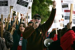 Culinary Union Secretary-Treasurer D. Taylor leads a chant during a  rally and picket line organized by the Culinary Union Local 226 to condemn Station Casinos' anti-union campaigns in front of Palace Station in Las Vegas Thursday, March 11, 2010.