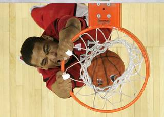 UNLV guard Anthony Marshall dunks against BYU during Friday's Mountain West Conference Tournament game. UNLV upset the No. 2-seeded Cougars 70-66 and will face San Diego State in the championship.