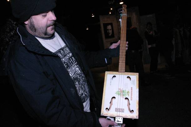 Super Fuzz and one of his custom cigar guitars.