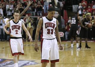 UNLV guards Tre'Von Willis and Kendall Wallace walk off the court after their Mountain West Conference championship game Saturday, March 13, 2010, against San Diego State University.