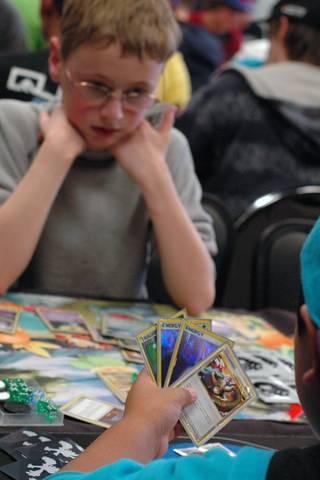 Ryan Hines waits for his opponent to make a move during the junior division championship round of the Pokemon Trading Card Game Nevada State Championship.