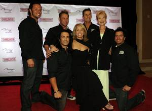 Dawn Gibbons and Dee Wallace pose for photos with the cast of Thunder From Down Under at Terry Fator's first-anniversary show at The Mirage on March 13, 2010.