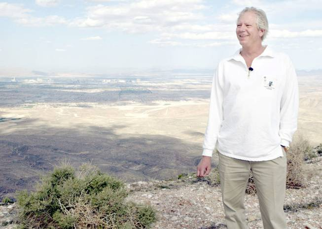 Developer Jim Rhodes smiles on Blue Diamond Hill on Monday, May 5, 2003. Las Vegas can be seen in the background.