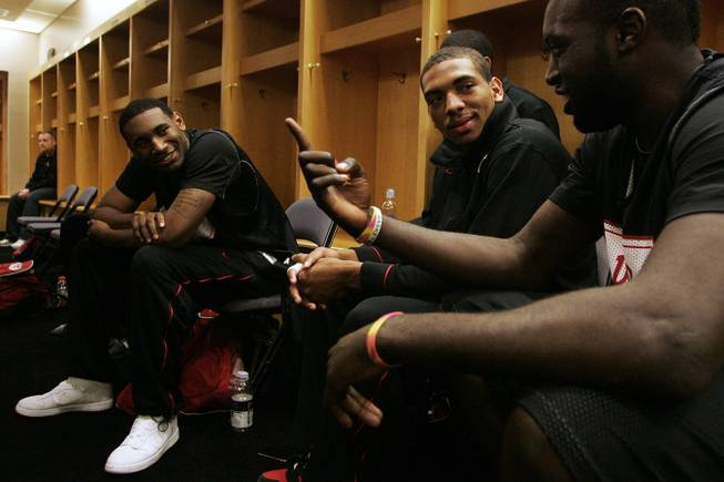 UNLV players Darris Santee (left), Anthony Marshall and Brice Massamba (right) chat in the locker room on March 17, 2010, before practice for the first round of the NCAA Basketball Championships at the Ford Center in Oklahoma City.