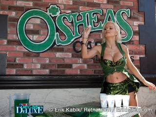Holly Madison celebrates St. Patrick's Day with a game of beer pong at O'Sheas on March 17, 2010.