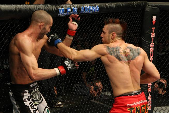 Dan Hardy (right) connects with a left hook to Mike Swick during their welterweight bout at UFC 105 on Nov. 14 2009. Hardy won the fight by unanimous decision.