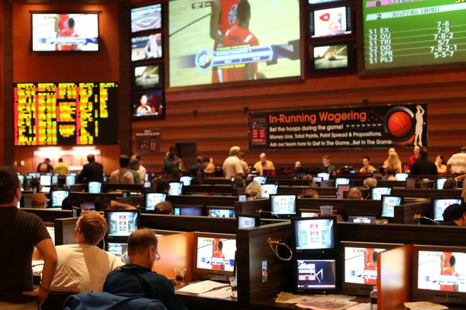 Bettors take in the first weekend of NCAA Tournament action in March 2010 at the M sports book. Northern Iowa was the most notable underdog to shake up the tournament picture heading in to the Sweet 16.