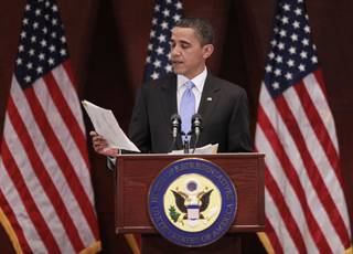 President Barack Obama reads letters that he has received during his visit to Capitol Hill to meet with House Democrats in Washington on Saturday.