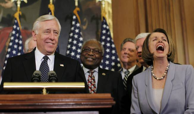 Speaker Nancy Pelosi of California laughs as Majority Leader Steny Hoyer of Maryland speaks during a press conference after the House passed health care reform in the U.S. Capitol in Washington, Sunday, March 21, 2010.