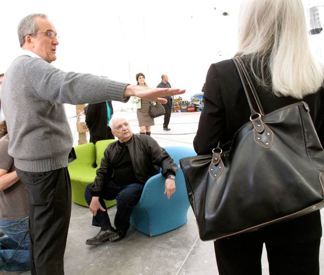 Larry Ruvo (left) and Libby Lumpkin (right) speak to renowned architect Frank Gehry (center) inside the Cleveland Clinic Lou Ruvo Center for Brain Health, which he designed.