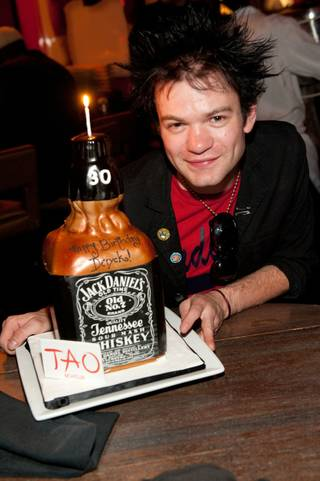 Sum 41 frontman Deryck Whibley receives his Jack Daniels cake to celebrate his 30th birthday at Tao in The Venetian on March 25, 2010.