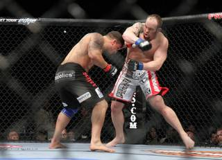 Shane Carwin, right, in action against Frank Mir during their heavyweight match at the Prudential Center in Newark, N.J., on Saturday, March 27, 2010.  Carwin won at 3:28 of the first round to take the UFC interim heavyweight title.