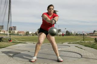 UNLV track and field thrower Amanda Bingson swings through the first rotation of her throw during practice Tuesday. Bingson, a sophomore, recently set a new UNLV hammer throw record of 183 feet, 4 inches.