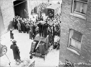 Spectators crowd the scene of the St. Valentine's Day Massacre in Chicago.