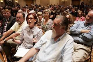 Lake Las Vegas resident Debera Hendricks speaks Thursday during a town hall meeting led by Clark County Commissioner Steve Sisolak at Loews Lake Las Vegas in Henderson.
