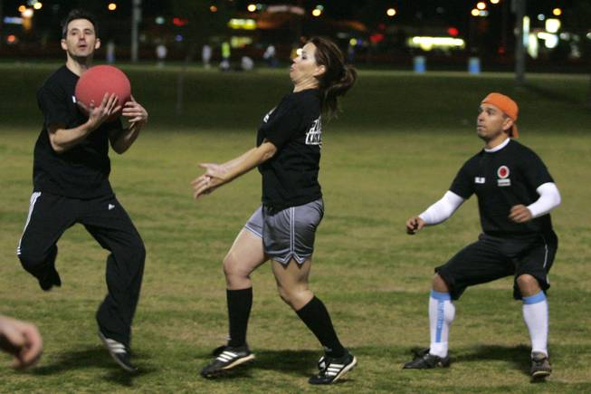 New Kickballers on the Block members Jordan Tayce (L) Tanya Abel and James Steinert converge to field a ball during the World Adult Kickball Association's first game of the season Wednesday, April 14, 2010 at Desert Breeze Park.