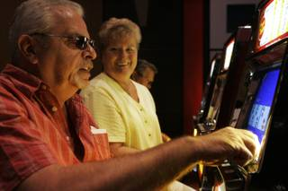 Jerry and Patsy Hale play video poker in the coin slot area at Eastside Cannery Thursday, April 15, 2010.