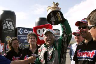 John Force celebrates his victory in the funny car division during the NHRA SummitRacing Nationals Sunday, April 18, 2010 at the Las Vegas Motor Speedway.