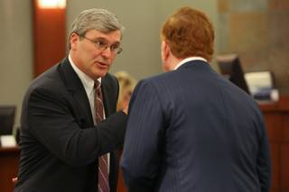 Attorney Mark Tully, representing drug companies, speaks with plaintiff's attorney Robert Eglet, right, during a break in the endoscopy trial on Monday, April 19, at the Regional Justice Center.