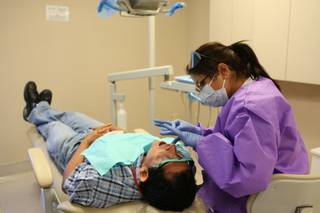 Jairo Alvarez relaxes while being prepped for a crown by dental assistant Angie Bateman on Tuesday at the Nevada Health Center at 2212 S. Eastern Ave.