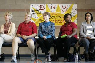 Members of the Clark County Education Association's negotiation committee sit at the front of the cafeteria Tuesday during a CCEA bargaining update meeting at Del Sol High School.