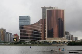 The newest resort Wynn Encore Macau, right, stands next to the Wynn Macau, left in center, in Macau Wednesday, April 21, 2010.