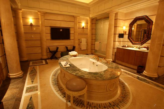 The Greek villa is one of three at Caesars Palace's Octavius Tower and is nearly 10,000 square feet. Shown here is the master bathroom.