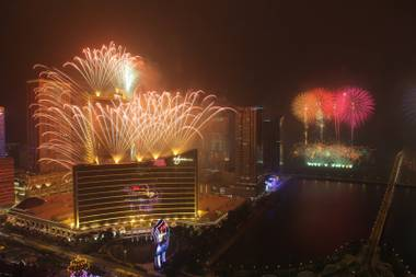 The Encore Macau grand opening fireworks illuminate the night sky above Wynn Macau on April 21, 2010.