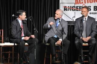 Gov. Jim Gibbons, center, answers questions with candidates Brian Sandoval, left, and Mike Montandon during the Republican gubernatorial debate in Reno on Friday, April 23, 2010.