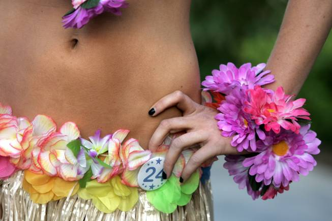 A contestant in the International Bikini Team Aloha State Finals poses for the Hawaiian-style portion of the competition Friday at the Silverton.
