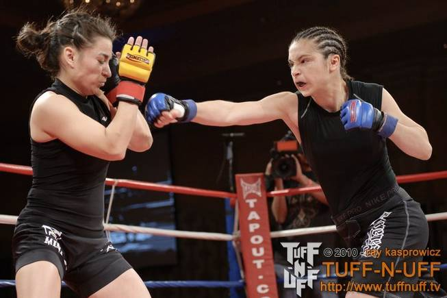 Ashley Cummins strikes Cathy Snell during the Tuff-N-UFF Amateur Fighting Championships at The Orleans on April 23, 2010. Cumins won the fight via unanimous decision.