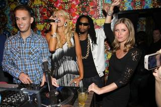 DJ Eric DLux, Paris Hilton, Lil Jon and Nicky Hilton at Vanity in the Hard Rock Hotel on April 24, 2010.