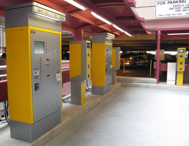 New Express Exit walk-up pay stations line the area between the passenger pickup area and the parking lot elevators at McCarran International Airport.