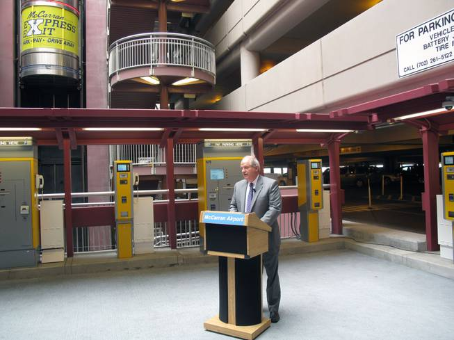 Director of Aviation Randall Walker speaks at a press conference Tuesday about McCarran International Airport's new Express Exit pay system for parking.
