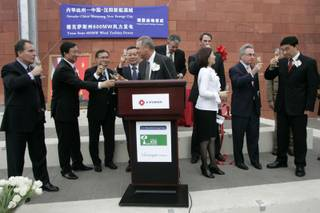 American and Chinese businessmen and dignitaries toast each other Tuesday at a ribbon-cutting ceremony announcing the launch of the final development phase of a wind turbine plant project involving A-Power Energy Generation Systems, Cielo Wind Services and the Greenspun Corporation.