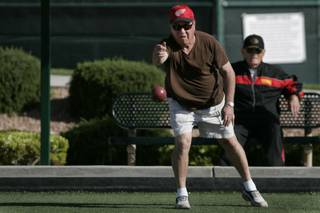 Joel Holzman lets loose with a ball while playing bocce ball on the Sun City Anthem courts Wednesday, April 28, 2010.