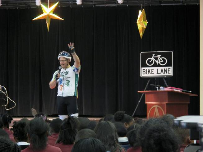 Regional Transportation Commission General Manager Jacob Snow speaks to students at Agassi College Preparatory Academy about the importance of wearing helmets while riding bicycles.