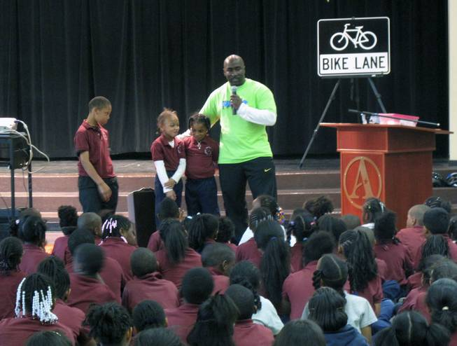Las Vegas City Councilman Ricki Barlow speaks to students at Agassi Prep on Nevada Moves Day about walking and biking to school.