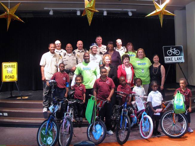 Students show off bicycles given away at a Nevada Moves Day event on Wednesday, April 28, 2010, at Agassi College Preparatory Academy.