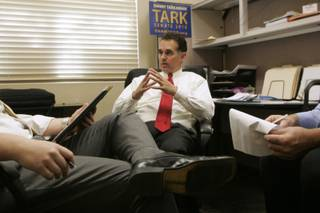 Policy director Ben Stecker (L) and volunteer Dean Stump help Danny Tarkanian prep for a Republican debate Friday, April 30, 2010.