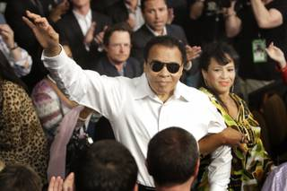 Boxing legend Muhammad Ali, center, is introduced before the welterweight fight between Floyd Mayweather Jr. and Shane Mosley Saturday at the MGM Grand Garden Arena on May 2, 2010.