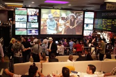 This sports bar on steroids has over 100 HD televisions and a gigantic TV in front of stadium-style rows of sofas