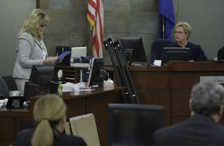 District Court Judge Jessie Walsh, right, listens as the court clerk reads a verdict in district court Wednesday, May 5, 2010. A jury found two companies that made and distributed the anesthetic propofol used at Desert Shadow Endoscopy Center liable on multiple counts.