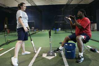 Former major league slugger Bill Madlock gives hitting instructions to Greenspun Junior High softball player Autumn Owens Wednesday, May 5, 2010.