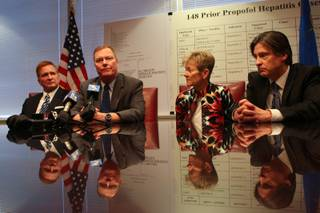 Henry Chanin answers questions from the news media regarding his physical health during a press conference following an award of $500 million in punitive damages Friday, May 7, 2010.  Seated from left, attorney Robert Eglet, Henry Chanin, Lorraine Chanin and attorney Will Kemp.