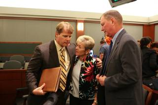 Attorney Robert Cottle stands with Henry and Lorraine Chanin after the jury's verdict is read May 7, 2011. Jurors awarded $500 million in punitive damage to the couple.